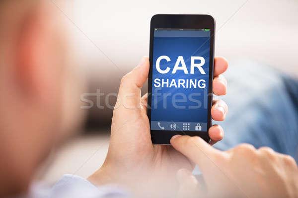 Man Using Car Sharing Application On Smart Phone Stock photo © AndreyPopov