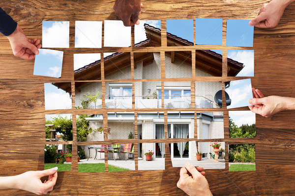 Group Of People Arranging The House Puzzle Stock photo © AndreyPopov