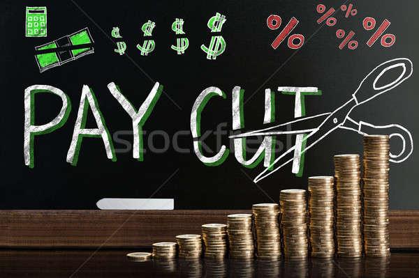 Fizetés jegyzettömb mögött egymásra pakolva érmék pénz Stock fotó © AndreyPopov