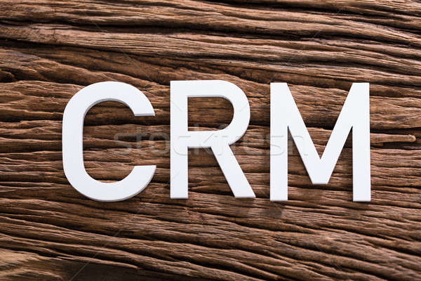 White CRM Text On Wooden Table Stock photo © AndreyPopov