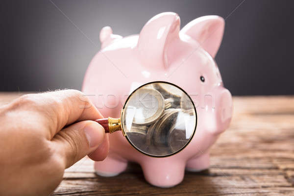 üzletember megvizsgál érmék persely nagyító kép Stock fotó © AndreyPopov
