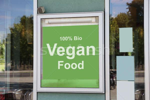 Vegan food sign outside modern restaurant building Stock photo © AndreyPopov