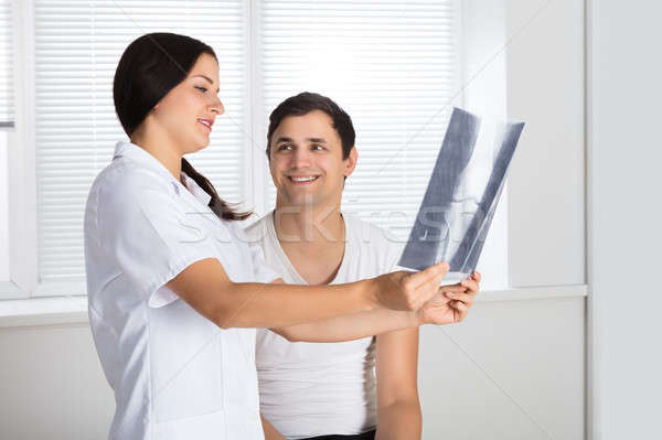 Doctor Showing Knee X-ray To Patient Stock photo © AndreyPopov