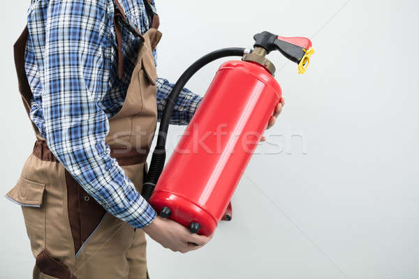 Technician Carrying Red Fire Extinguisher Stock photo © AndreyPopov
