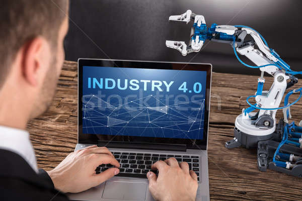 Working On Design Of Industrial Robot Arm On Laptop Stock photo © AndreyPopov
