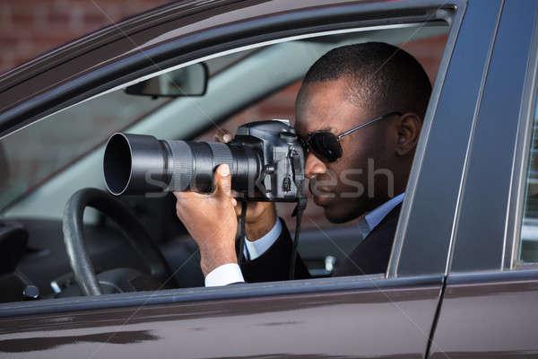 Nyomozó ül bent autó fényképezés kéz Stock fotó © AndreyPopov