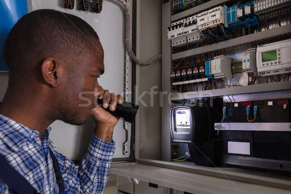 Electrician Examining A Electric Meter Stock photo © AndreyPopov
