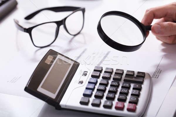 Businessman Hand Examining Invoice Stock photo © AndreyPopov