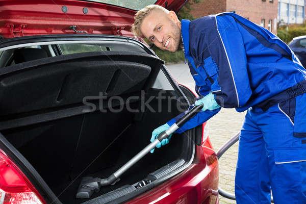 Man Vacuuming Car Trunk Stock photo © AndreyPopov