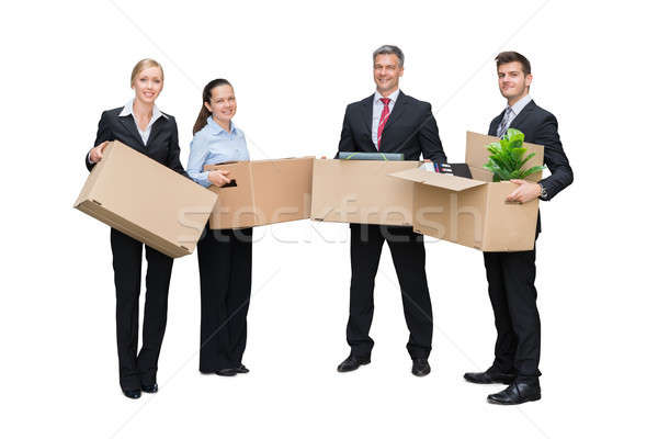 Happy Businesspeople Holding Cardboard Box With Their Belongings Stock photo © AndreyPopov