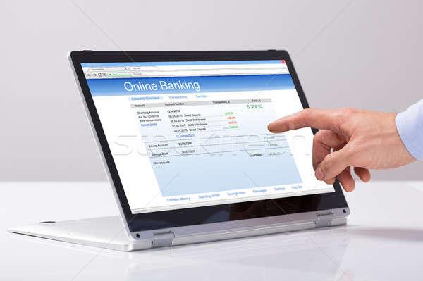 Férfiak kéz online bankügylet hibrid laptop Stock fotó © AndreyPopov