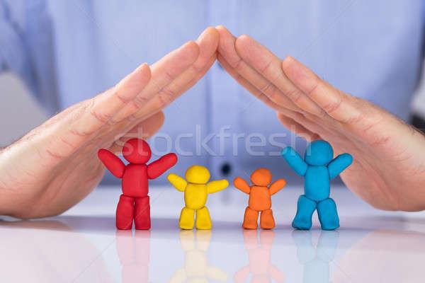 Kéz színes család felfelé agyag fehér Stock fotó © AndreyPopov