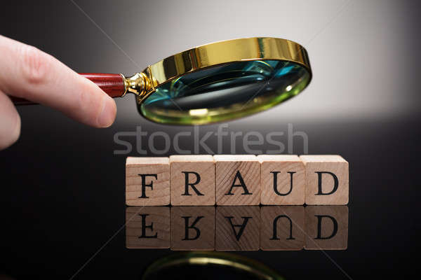 Personne fraude blocs loupe Photo stock © AndreyPopov