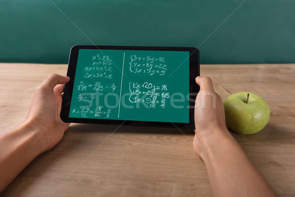 Student Solving Math Problem On Digital Tablet Stock photo © AndreyPopov