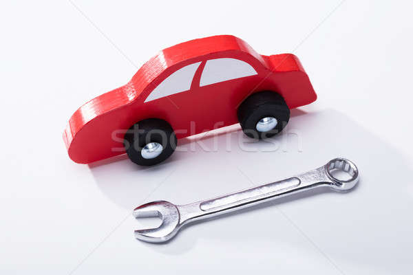 Elevated View Of Red Car And Wrench Stock photo © AndreyPopov