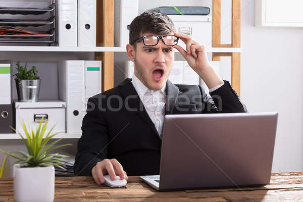 Shocked Businessman Looking At Laptop Stock photo © AndreyPopov