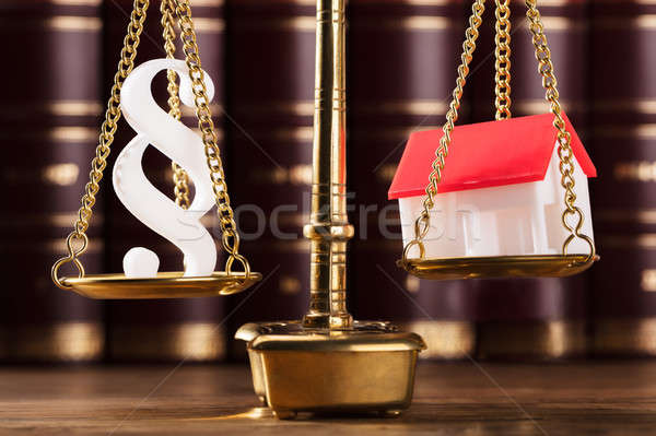 Paragraph Symbol And House Model On Justice Scale Stock photo © AndreyPopov