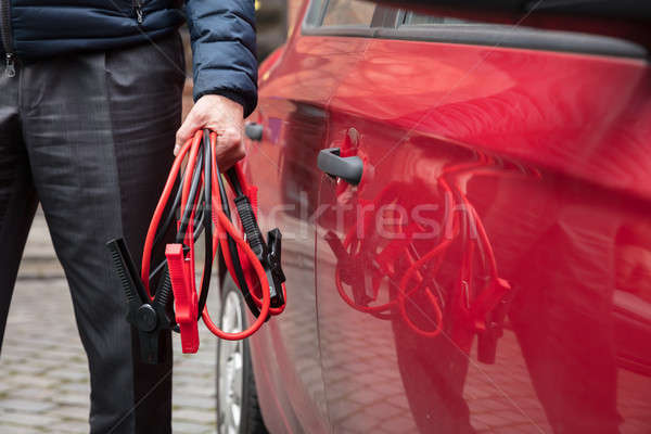 Stock photo: Person's Hand Holding Jumper Cables