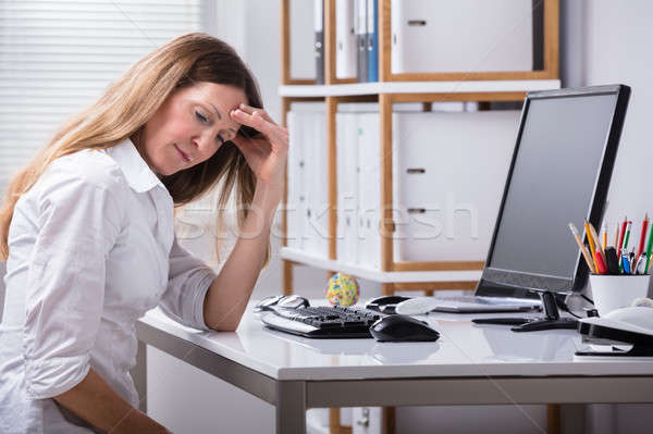 Stock photo: Mature Businesswoman Suffering From Headache