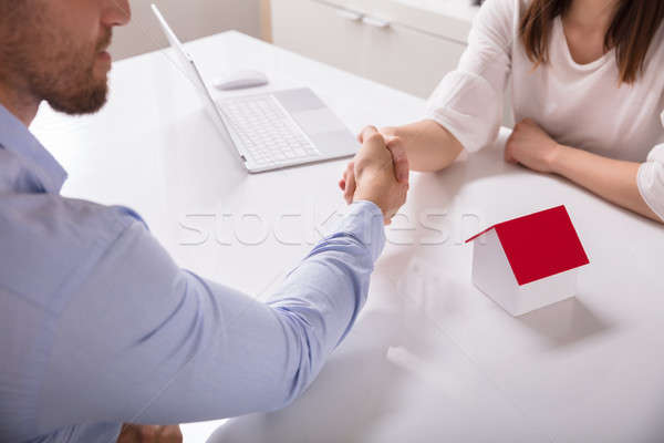 Real Estate Agent Shaking Hand With His Client Stock photo © AndreyPopov