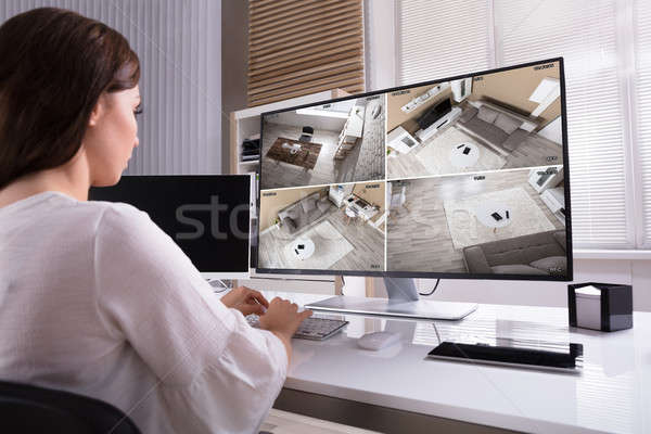 Businesswoman Monitoring CCTV Footage On Computer Stock photo © AndreyPopov