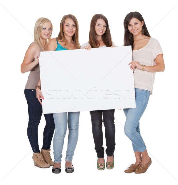 Négy vonzó lányok tart fehér tábla stúdiófelvétel Stock fotó © AndreyPopov