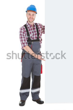 Happy Worker Pointing On Placard Stock photo © AndreyPopov