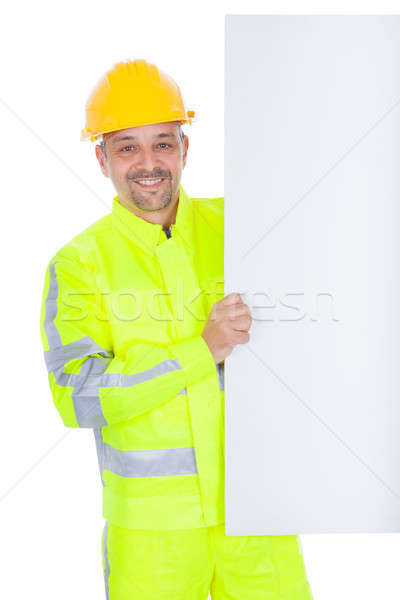 Worker in safety jacket presenting empty board Stock photo © AndreyPopov