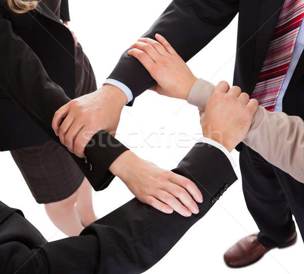 Businesspeople linking hands - teamwork Stock photo © AndreyPopov