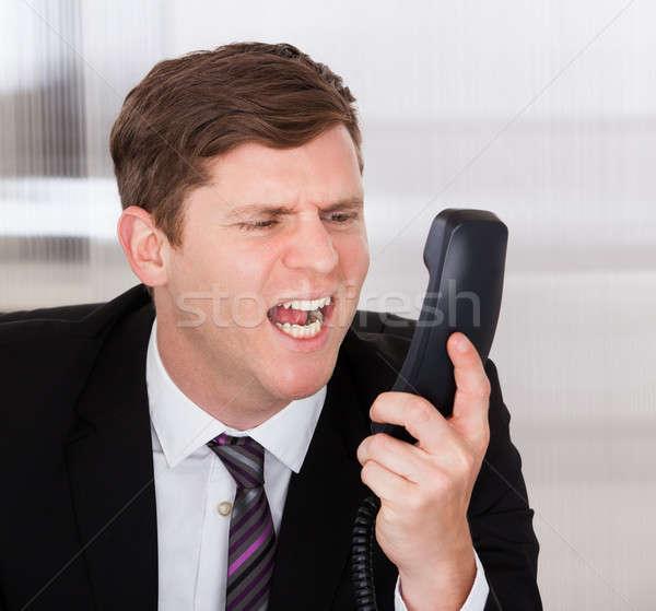 Businessman shouting on telephone Stock photo © AndreyPopov