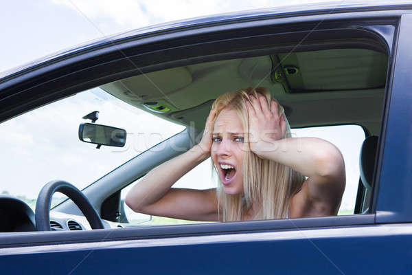 Frustrated Woman Screaming Sitting In Car Stock photo © AndreyPopov