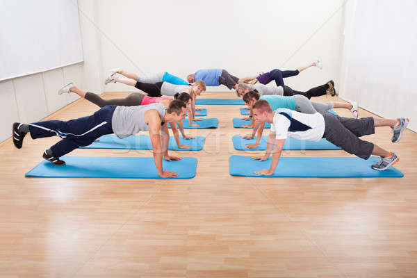 Large class of people working out in a gym Stock photo © AndreyPopov