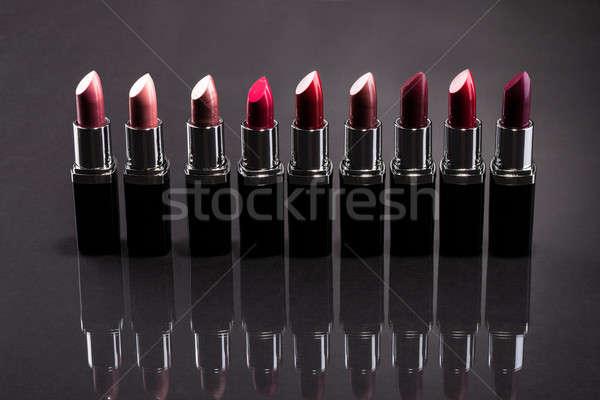 Csetepaté izolált szürke háttér piros szín Stock fotó © AndreyPopov