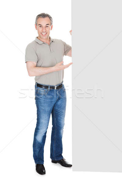Happy Mature Man Standing Behind Placard Stock photo © AndreyPopov