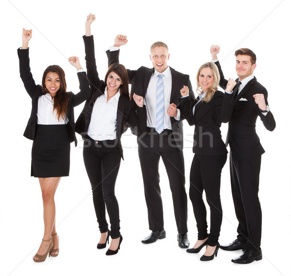 Successful Welldressed Businesspeople With Arms Raised Stock photo © AndreyPopov