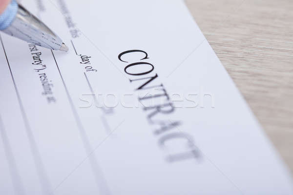 Contract Paper And Pen On Desk Stock photo © AndreyPopov