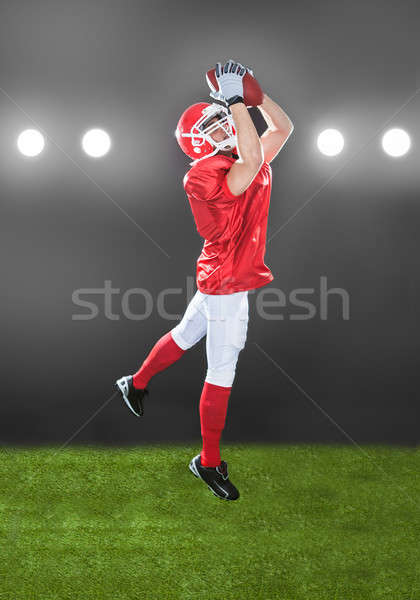 American Football Player Jumping On Field Stock photo © AndreyPopov
