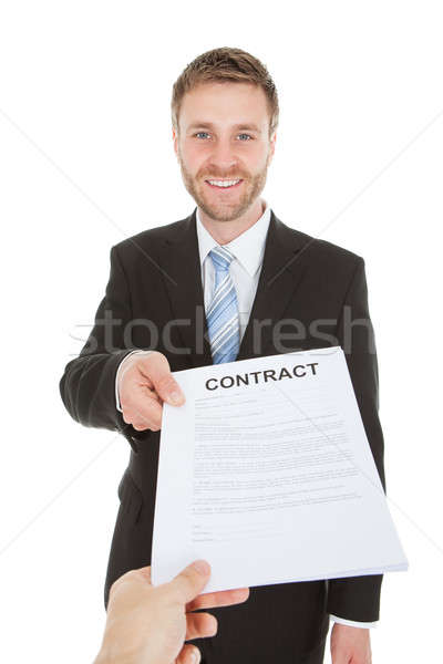 Happy Businessman Giving Contract Paper Over White Background Stock photo © AndreyPopov