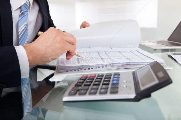 Imprenditore costo ufficio immagine desk Foto d'archivio © AndreyPopov