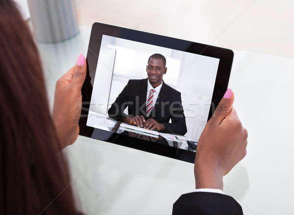 Businesswoman Attending Video Conference Stock photo © AndreyPopov
