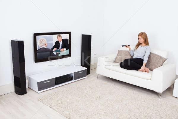 женщину смотрят фильма телевидение портрет Сток-фото © AndreyPopov