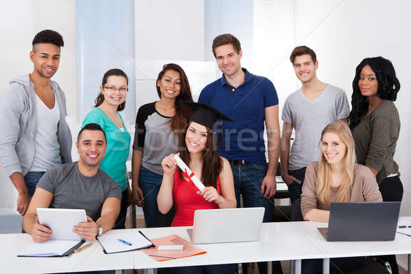 University Student Holding Degree In Classroom Stock photo © AndreyPopov