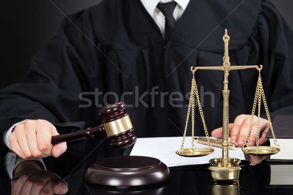 Judge With Mallet And Weight Scale At Desk Stock photo © AndreyPopov