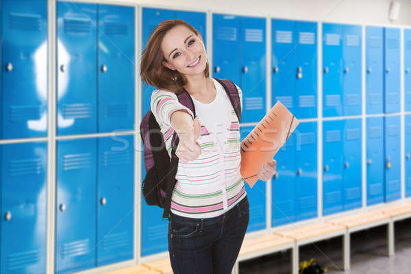Female College Student Showing Thumb-up Stock photo © AndreyPopov