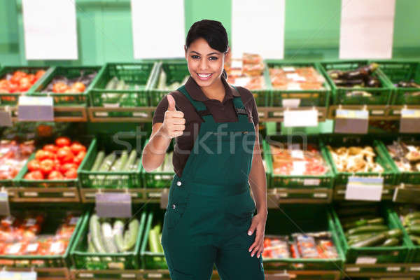 Female Sales Clerk Showing Thumb Up Gesture Stock photo © AndreyPopov