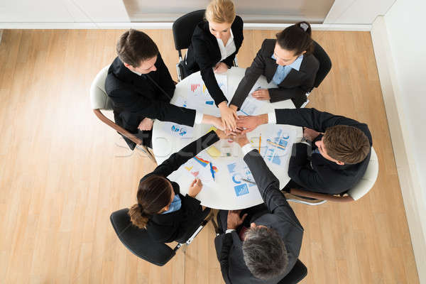 Businesspeople Stacking Hands Together Stock photo © AndreyPopov