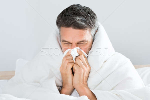 Mature Man Blowing His Nose Stock photo © AndreyPopov