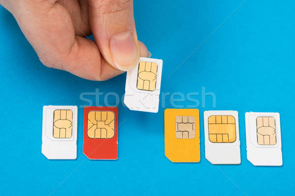Person Hand With Sim Cards Stock photo © AndreyPopov