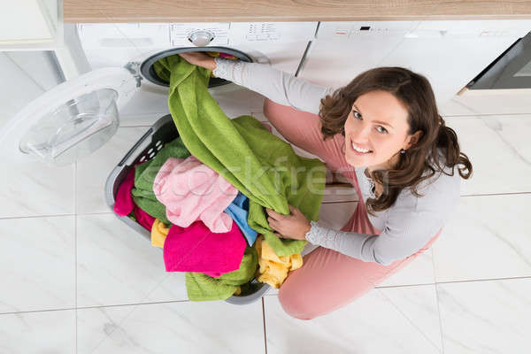 Woman Loading Clothes In Washer Stock photo © AndreyPopov