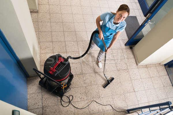 Janitor Vacuuming Floor Stock photo © AndreyPopov